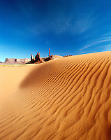 USA, Arizona. Monument Valley Navajo Tribal Park. Sand dunes and rock formations of Totem Pole and Yei Bi Che