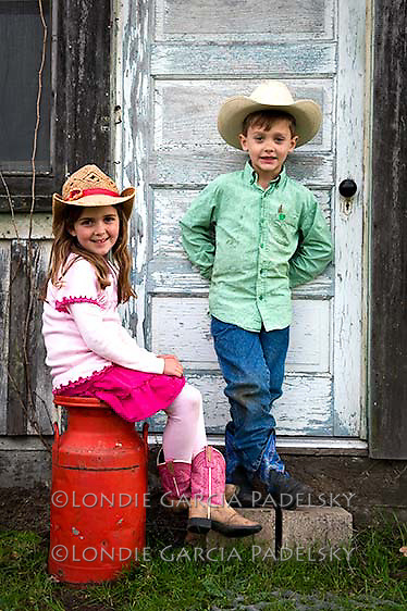 Cowboy kids posing infront of the bunkhouse. San Luis Obispo, California