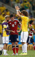 FORTALEZA - BRASIL -04-07-2014. Foto: Roberto Candia / Archivolatino<br /> James Rodriguez (#10) jugador de Colombia (COL) conversa con Dani Alves (#2) y David Luiz (#4) jugadores de Brasil (BRA) después del partido de los cuartos de final por la Copa Mundial de la FIFA Brasil 2014 jugado en el estadio Castelao de Fortaleza./ James Rodriguez (#10) player of Colombia (COL) talks with Dani Alves (#2) y David Luiz (#4) players of  Brazil (BRA) after the match of the Quarter Finals for the 2014 FIFA World Cup Brazil played at Castelao stadium in Fortaleza. Photo:  Roberto Candia / Archivo Latino<br /> VizzorImage PROVIDES THE ACCESS TO THIS PHOTOGRAPH ONLY AS A PRESS AND EDITORIAL SERVICE IN COLOMBIA AND NOT IS THE OWNER OF COPYRIGHT; ANOTHER USE IS REPONSABILITY OF THE END USER. NO SALES, NO MERCHANDASING. ALL COPYRIGHT IS ARCHIVOLATINO