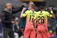 6th November 2019, Milan, Italy; UEFA Champions League football, Atalanta versus Manchester City; <br /> Josep Guardiola coach of Manchester City  speaks to his plaers Kevin De Bruyne and Riyad Mahrez during a break in play
