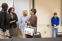 Ayanna Pressley (second from left) greets people after speaking at an event put on by Chelsea Black Community at the Chelsea Senior Center in Chelsea, Massachusetts, USA, on Wed., June 27, 2018. Pressley is running in the Democratic primary Massachusetts 7th Congressional District against incumbent Mike Capuano. Pressley is currently serving as a member of the Boston City Council, and is the first woman of color elected to the Council.