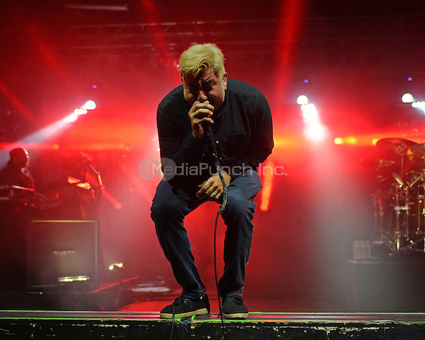 POMPANO BEACH FL - MAY 13: Chino Moreno of Deftones performs at The Pompano Beach Amphitheater on May 13, 2016 in Pompano Beach, Florida. Credit: mpi04/MediaPunch