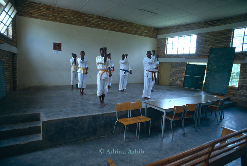 Tutsi men training in Karate.  Fears of an imminent Hutu attack had many  training in self-defence in October 1993, they had little idea what was to come.