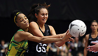 24.02.2018 Silver Ferns Ameliaranne Ekenasio and Jamaica's Shamera Sterling in action during the Silver Ferns v Jamaica Taini Jamison Trophy netball match at the North Shore Events Centre in Auckland. Mandatory Photo Credit ©Michael Bradley.