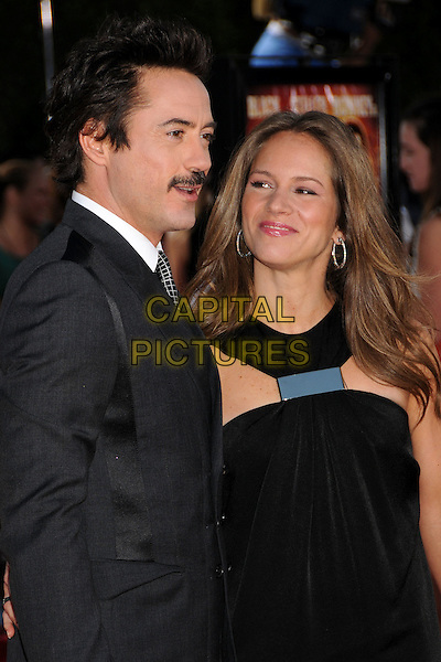 "ROBERT DOWNEY JR. & SUSAN LEVIN.""Tropic Thunder"" Los Angeles Premiere at Mann's Village Theatre, Westwood, California, USA. .August 11th, 2008 .half length black suit jacket dress married husband wife moustache grey gray mustache facial hair .CAP/ADM/BP.©Byron Purvis/AdMedia/Capital Pictures."
