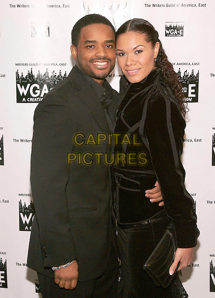 LARENZ TATE & TOMASINA.At the Writer's Guild of America, East (WGAE) 58th Annual Awards Ceremony held at Waldorf Astoria, New York, NY, USA, 04 February 2006..half length hugging arm around waist.Ref: ADM/JL.www.capitalpictures.com.sales@capitalpictures.com.© Capital Pictures.