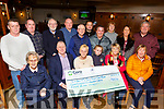 The Moran family presenting cheques to Pieta House, Cuan Mhuire and MS Society, proceeds from the Grace Moran Memorial Walk in the Kerins O&rsquo;Rahillys club on Monday night.<br /> Seated l-r, Sr Agnes (Cuan Mhuire), Con O&rsquo;Connor (Pieta House), Eileen Moran, Lexi Keane Moran, Audrey Moran and Ann Burrows (MS Society).<br /> Back l-r, Bobby Maher, Brendan O&rsquo;Reilly, Martin Brosnan, Martin O&rsquo;Shea, Jimmy Moran, Danny Coffey, Sean Moran, Pat Turner (Pieta House), Eileen Whelan, Henry Burrows (MS Society).