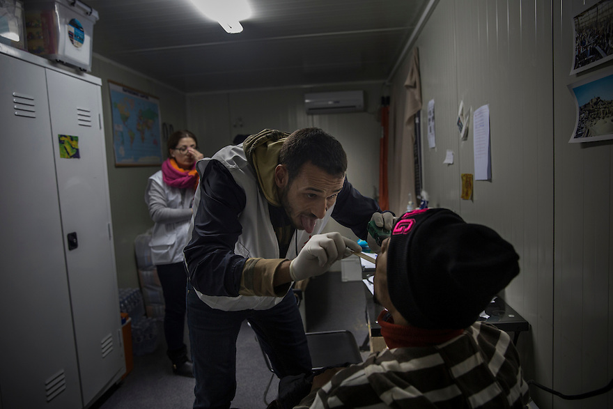 Dr. Hassan Abuhamdan cares for a Somali immigrant at the MSF container clinic in Idomeni, Greece, where several thousand people were stranded in November until December 9, when police transported them en masse to Athens. Many were unable to cross into Macedonia due to nationality restrictions put in place by several Balkan nations. Meanwhile many thousands of Syrians, Afghans and Iraqis passed through the border each day after having their documents checked by Macedonian border police.