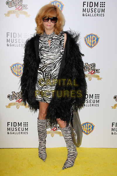 LINDA RAMONE .Warner Bros And FIDM Presents 'The Wizard of Oz Exhibition Opening Night Gala Held at FIDM Museum & Galleries, Los Angeles, California, USA..June 9th, 2009.full length black white zebra animal print dress boots fur coat jacket sunglasses shades .CAP/ADM/KB.©Kevan Brooks/AdMedia/Capital Pictures.