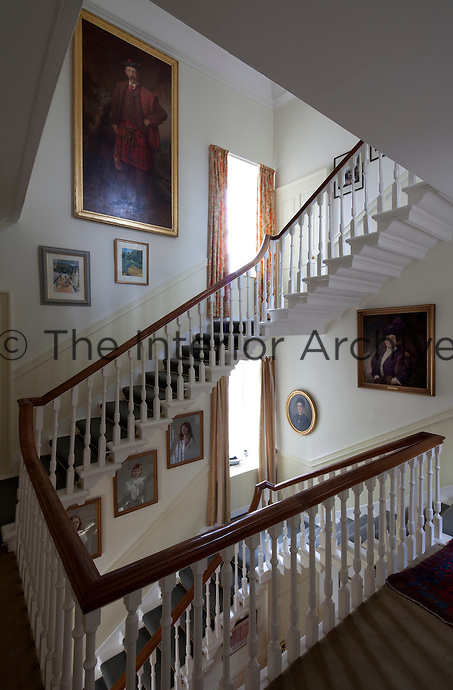 The family portraits hang on the walls of the eighteenth century staircase in the post-1745 wing of the house