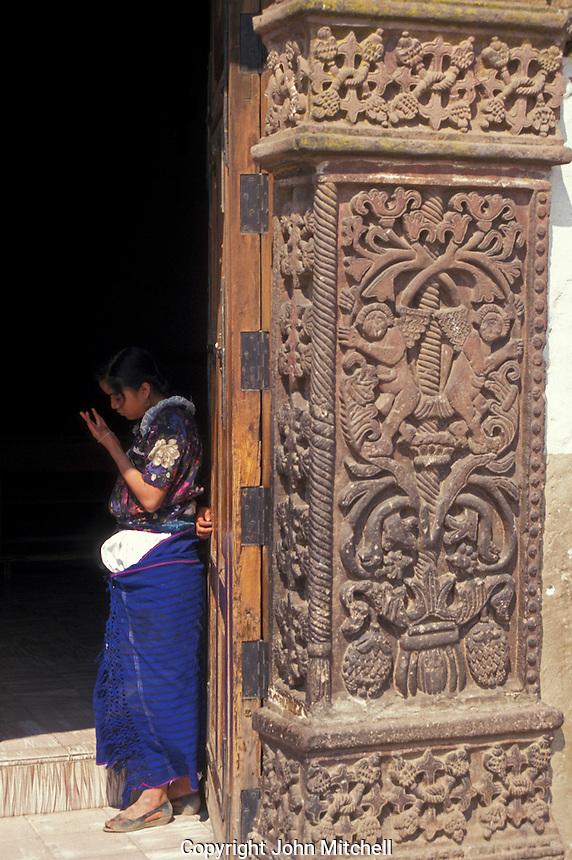 Purepecha girl standing in the Moorish doorway of the 16th-century Iglesia de Santiago Apostol in the village of Angahuan, Michoacan, Mexico.