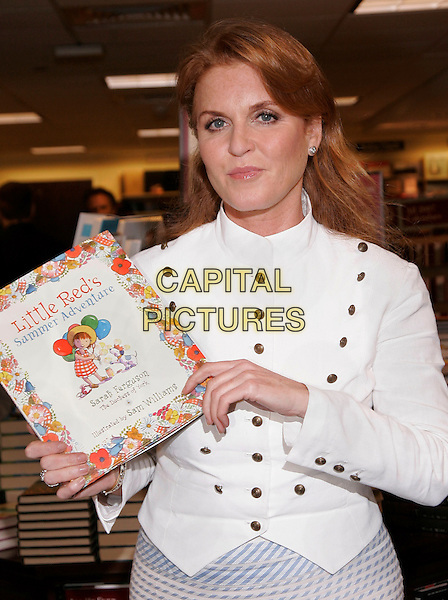 SARAH FERGUSON - DUCHESS OF YORK .Signs her children's book 'Little Red's Summer Adventure' at Barnes & Noble,New York, NY, USA..June 27th, 2006.Photo: Jackson Lee/AdMedia/Capital Pictures.Ref: JL/ADM.half length fergie white top jacket brass buttons .www.capitalpictures.com.sales@capitalpictures.com.© Capital Pictures.