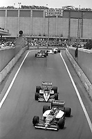 DETROIT, MI - JUNE 22: Nelson Piquet of Brazil drives the Williams FW11/Honda RA166E ahead of Jacques Laffite of France in the Ligier JS27/Renault EF4B, Stefan Johansson of Sweden in the Ferrari F1-86/Ferrari 032 and Alain Prost of France in the McLaren MP4-2C/TAG TTE PO1 during the Detroit Grand Prix FIA Formula One World Championship race on the Detroit Street Circuit in Detroit, Michigan, on June 22, 1986..
