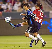 Chivas USA defender Jonathan Bornstein (13) battles San Jose Earthquakes forward Chris Wondolowski (8). CD Chivas USA defeated the San Jose Earthquakes 3-2 at Home Depot Center stadium in Carson, California on Saturday April 24, 2010.  .