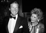 Roger Moore and his wife attending Friars Club Roast at the waldorf Astoria Hotel in New York City on <br />May 1, 1983