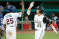 San Antonio Missions third baseman James Darnell #25 is greeted by Midland's Jermain Mitchell #25 after Darnell hit a two run home run during the Texas League All Star Game played on June 29, 2011 at Nelson Wolff Stadium in San Antonio, Texas. The South All Star team defeated the North All Star team 3-2 and Darnell was awarded the MVP award. (Andrew Woolley / Four Seam Images)