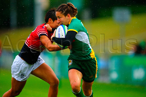 23.08.2015. Dublin, Ireland. Women's Sevens Series Qualifier 2015. Brazil versus Hong Kong<br /> Thais Rocha (Brazil) is tackled by Pak Yan Poon (Hong Kong).