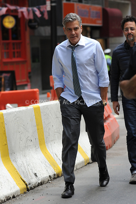 WWW.ACEPIXS.COM<br /> April 18, 2015 New York City<br /> <br /> George Clooney on the film set of 'Money Monster' in the Financial District of Manhattan on April 18, 2015 in New York City. <br /> <br /> By Line: Kristin Callahan/ACE Pictures<br /> ACE Pictures, Inc.<br /> tel: 646 769 0430<br /> Email: info@acepixs.com<br /> www.acepixs.com