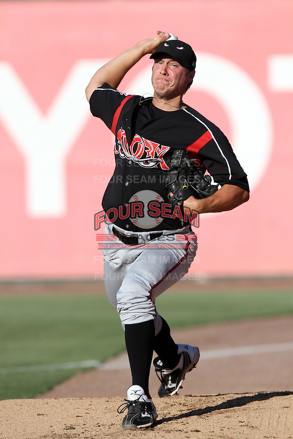 Mark Pope #12 of the Lake Elsinore Storm warms up before pitching against the Inland Empire 66'ers at San Manuel Stadium on July 15, 2012 in San Bernardino, California. Inland Empire defeated Lake Elsinore 4-3. (Larry Goren/Four Seam Images)