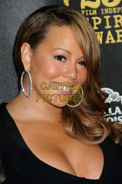 MARIAH CAREY .25th Annual Film Independent Spirit Awards - Press Room held at the Nokia Event Deck at L.A. Live, Los Angeles, California, USA, 5th March 2010.. indie portrait headshot smiling black cleavage hoop earrings .CAP/ADM/BP.©Byron Purvis/AdMedia/Capital Pictures.