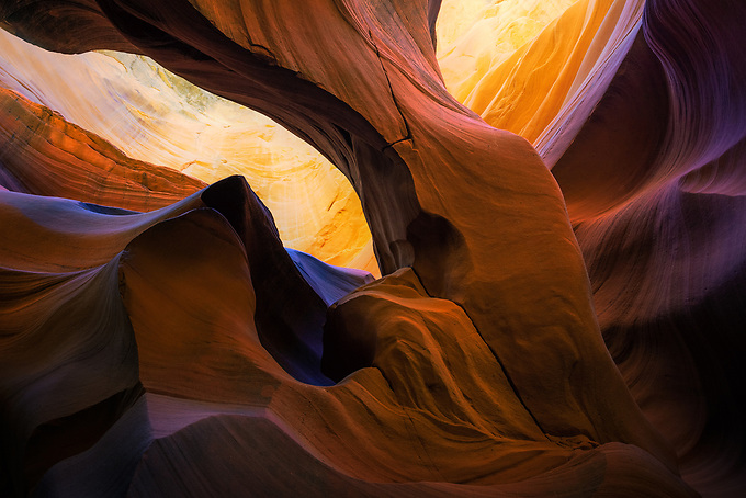 A unique and unexpected arch formed deep within a remote slot canyon in Arizona.