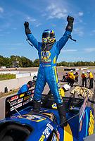 Aug 18, 2019; Brainerd, MN, USA; NHRA funny car driver Ron Capps celebrates after winning the Lucas Oil Nationals at Brainerd International Raceway. Mandatory Credit: Mark J. Rebilas-USA TODAY Sports