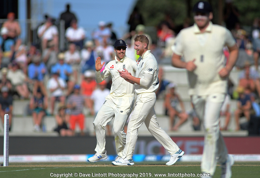 England's Ben Stokes celebrates dismissing NZ's Ross Taylor with Jack Leach (left) during day two of the international cricket 1st test match between NZ Black Caps and England at Bay Oval in Mount Maunganui, New Zealand on Friday, 22 November 2019. Photo: Dave Lintott / lintottphoto.co.nz