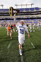 Parker McKee (35) of Duke hoists the trophy after the NCAA Men's Lacrosse Championship held at M&T Stadium in Baltimore, MD.  Duke defeated Notre Dame, 6-5, to win the title in overtime.