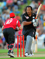 Tana Umaga looks back at Adam Parore after swinging and missing Shane Warne's delivery. Fill The Basin for Christchurch fundraising cricket match - Canterbury Invitational XI v Wellington Legends XI  at Hawkins Basin Reserve, Wellington, New Zealand on Sunday, 13 March 2011. Photo: Dave Lintott / lintottphoto.co.nz