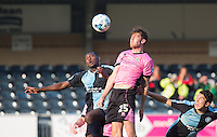 Shaun Brisley of Northampton Town wins the ball in the air during the Sky Bet League 2 match between Wycombe Wanderers and Northampton Town at Adams Park, High Wycombe, England on 3 October 2015. Photo by Andy Rowland.