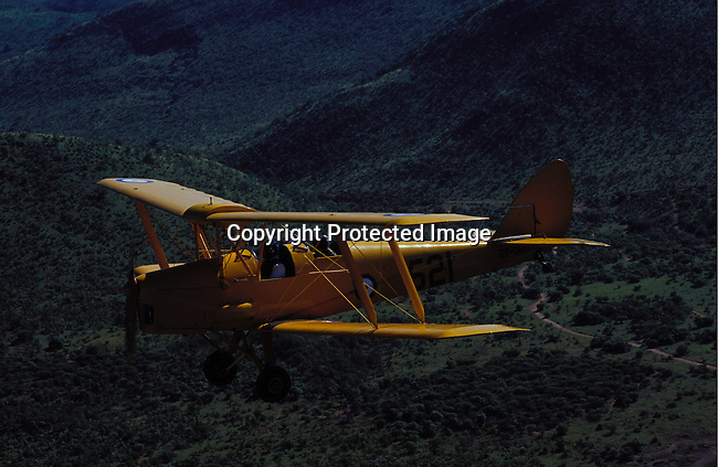 ditrans00371.Transport. Aeroplanes. An old plane called Tiger Mouth May 9, 2003, flying over Sun City, South Africa. These planes can be rented and are used by wealthy foreigners visiting the country. Tourist attraction..©Per-Anders Pettersson/iAfrika Photos.
