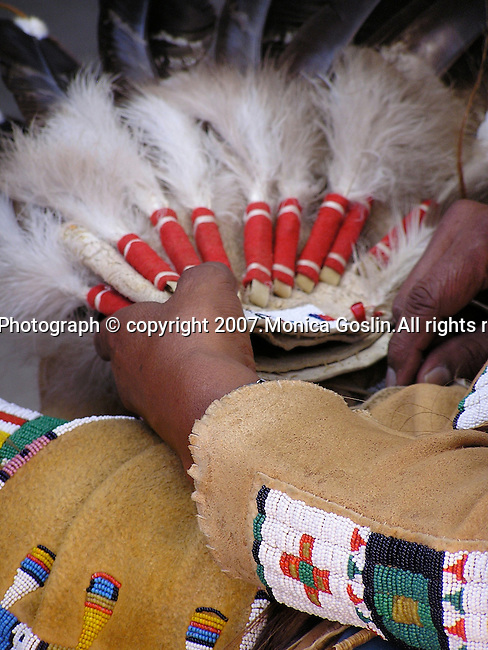 Detail of a mans hands at the costume contest at the Indian Market in Santa Fe, New Mexico.