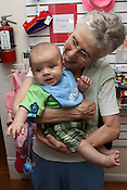 May 29, 2010.  Chapel Hill, North Carolina.  .Grandmother poses with grandson at the Red Hen-children's clothing store.