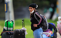 BOGOTA, COLOMBIA - April 13:  A woman looks on as migrants from Venezuela head to their country due to COVID-19 pandemic on April 13, 2020 in Bogota, Colombia. COVID-19 pandemic has now at least 2 million cases worldwide and  1,864,629 people dead.  (Photo by Daniel Munoz/VIEWpress)