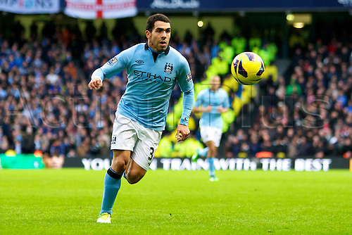 09.12.2012 Manchester, England. Manchester City's Argentinean forward Carlos Tévez in action during the Premier League game between Manchester City and Manchester United from the Etihad Stadium. Manchester United scored a late winner to take the game 2-3.
