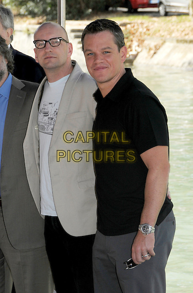 "STEVE SODERBERGH & MATT DAMON.Photocall for ""The informant!"" at Palazzo del Casino during the 66th Venice Film Festival, Venice, Italy..September 7th, 2009.half length beige brown suit jacket blue top black glasses watch.CAP/RD.©Richard Dean/Capital Pictures."