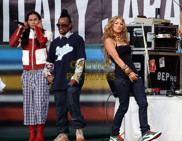 July 2, 2005 - Philadelphia, Pennsylvania - Fergie and the Black Eyed Peas. Live 8 is a series of nine concerts taking place in Philadelphia, London, Paris, Berlin, Rome, Tokyo, Toronto, Johannesburg and Moscow on four continents on the same day to raise awareness to call for an end to extreme poverty in Africa. Photo Credit: Laura Farr/AdMedia