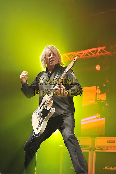 Rick Parfitt.Status Quo performing live in concert, O2 Arena, Greenwich, London, England. .11th December 2011.on stage gig performance music full length black shirt trousers guitar half 3/4.CAP/MAR.© Martin Harris/Capital Pictures.