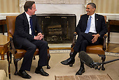 United States President Barack Obama, right, talks to Prime Minister David Cameron, of Great Britain in the Oval Office of the White House in Washington, D.C., U.S., on Monday, May 13, 2013. Cameron rebuked lawmakers in his Conservative Party who have already decided that Britain should withdraw from the European Union. .Credit: Andrew Harrer / Pool via CNP