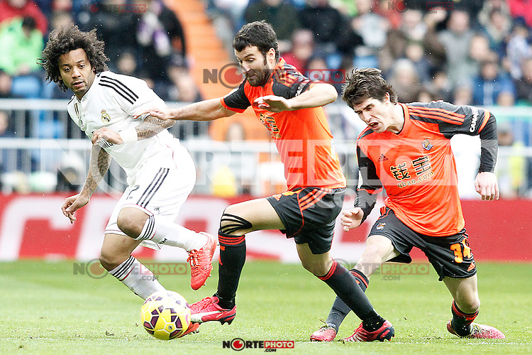 Real Madrid's Marcelo Vieira (l) and Real Sociedad's Imanol Agirretxe (c) and Aritz Elustondo during La Liga match.January 31,2015. (ALTERPHOTOS/Acero) /NortePhoto<br />