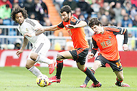 Real Madrid's Marcelo Vieira (l) and Real Sociedad's Imanol Agirretxe (c) and Aritz Elustondo during La Liga match.January 31,2015. (ALTERPHOTOS/Acero) /NortePhoto<br /> /NortePhoto.com