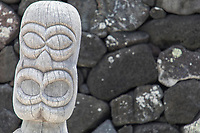Ki'i or tiki (carved images) guard a recreated heiau or temple at Pu'uhonua o Honaunau, Hawai'i Island.
