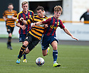 Alloa's Kevin Cawley and Livy's Ross Docherty challenge for the ball.