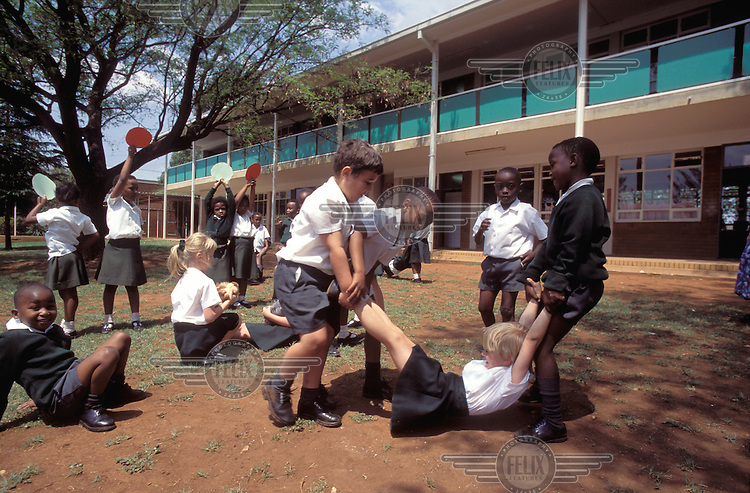 © Giacomo Pirozzi / Panos Pictures..SOUTH AFRICA..Kids playing in a multi-racial school.