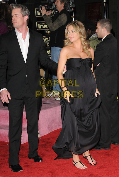 ERIC DANE & REBECCA GAYHEART.L.A. Premiere of Valentine's Day held at The Grauman's Chinese Theatre in Hollywood, California, USA. .February 8th, 2010.full length married husband wife black suit jacket strapless dress profile  pregnant .CAP/RKE/DVS.©DVS/RockinExposures/Capital Pictures.