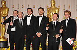 HOLLYWOOD, CA. - March 07: Presenters Bradley Cooper and Gerard Butler (both center) pose with (L-R) Joe Letteri, Stephen Rosenbaum, Richard Baneham and Andrew Jones, winners of Best Visual Effects for 'Avatar,' pose in the press room at the 82nd Annual Academy Awards held at the Kodak Theatre on March 7, 2010 in Hollywood, California.