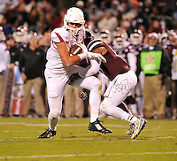 NWA Media/Michael Woods --11/01/2014-- w @NWAMICHAELW... University of Arkansas tight end hunter Henry is tackled in the 4th quarter of Saturday nights game against Mississippi State at Davis Wade Stadium in Starkville, Mississippi.