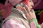 Djennet, au téléphone, dans une ancienne usine reconvertie en lieu fashion où se mêlent designers, magasins de mode underground et graffitis. Djennet est tatouée de la tête au pieds,  elle a crée une agence de mannequin où toutes les modèles sont tatouées.///// Djennet, on the phone, in an old factory converted into a fashion place where designers, underground fashion stores and graffiti mingle. Djennet is tattooed from head to toe, she created a model agency where all models are tattooed.