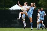 07 September 2014: North Carolina's Cameron Castleberry (21) and Arkansas' Katie Moore (left). The University of North Carolina Tar Heels played the University of Arkansas Razorbacks at Koskinen Stadium in Durham, North Carolina in a 2014 NCAA Division I Women's Soccer match. UNC won the game 2-1.
