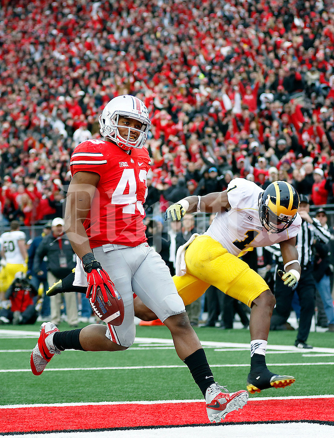 Ohio State Buckeyes linebacker Darron Lee (43) scores after recovering a fumble past Michigan Wolverines wide receiver Devin Funchess (1) during the fourth quarter of the NCAA football game against Michigan at Ohio Stadium on Saturday, November 29, 2014. (Columbus Dispatch photo by Jonathan Quilter)